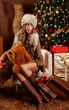 Tired pretty woman with Christmas presents Royalty Free Stock Image