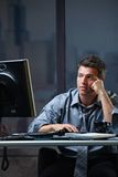Tired professional looking at screen troubled Stock Images