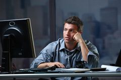 Tired professional looking at screen troubled Royalty Free Stock Photos
