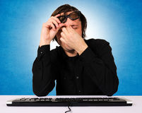 Tired programmer. With big time headache Stock Image