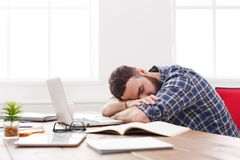 Overworked exhausted manager sleeping on table after working day Royalty Free Stock Photography