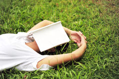 Tired of reading on grass Stock Photography