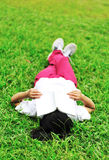 Tired of reading on green grass Stock Photography