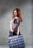 Tired redhaired woman with shopping bag. Stock Photos