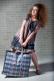 Tired redhaired woman with shopping bag Stock Images