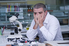 Tired researcher Royalty Free Stock Photo