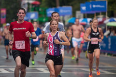 Tired Runners Push For Finish Line At Peachtree Road Race Stock Photo