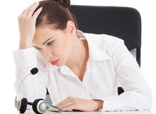 Tired, sad business woman at call center. Royalty Free Stock Photos