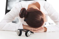 Tired, sad business woman at call center. Stock Image
