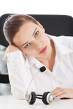 Tired, sad business woman at call center. Royalty Free Stock Images