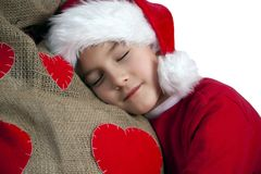 Tired santa boy Stock Photography