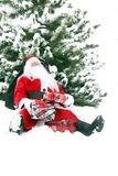 Tired Santa Claus in the snow Stock Images