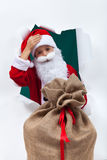 Tired santa with large bag Stock Photos