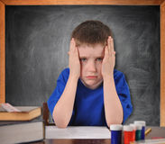 Tired School Child with Stress in Classroom Royalty Free Stock Photography