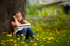 Tired of school girl with books Stock Photo