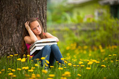 Tired school girl in the park Royalty Free Stock Photography