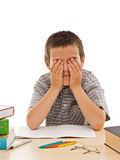 Tired schoolboy. Covering his eyes - isolated Royalty Free Stock Image