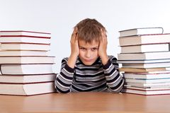 Tired schoolboy. On a white background Stock Image