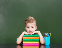 Tired schoolboy in classroom.  Royalty Free Stock Photography