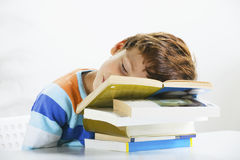 Tired schoolboy studying in home. Royalty Free Stock Photo