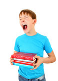 Tired Schoolboy yawning. Schoolboy with the Books Yawning Isolated on the White Background Stock Images