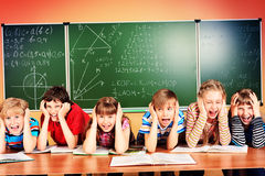 Tired schoolchildren Royalty Free Stock Images