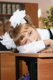 The tired schoolgirl. The schoolgirl lies on a school desk Stock Photo