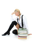 Tired schoolgirl with books Stock Photo