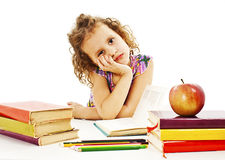Tired schoolgirl with learning difficulties Royalty Free Stock Images