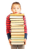 Tired schoolgirl with a pile of books Royalty Free Stock Photography