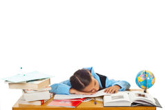 Tired schoolgirl sleeping on books Royalty Free Stock Photo