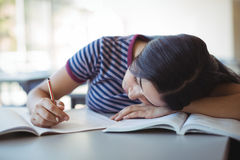 Tired schoolgirl sleeping in classroom Stock Photography