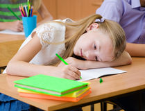 Tired schoolgirl spoils the eyesight during the exam Stock Photography