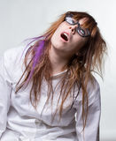 Tired scientist shaggy woman. On gray background Royalty Free Stock Photos