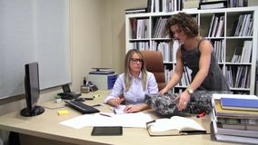 Tired secretary with lot of work in the office stock video footage