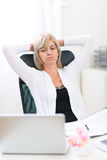 Tired senior business woman looking on computer Royalty Free Stock Image
