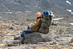 Tired senior hiker in mountain Royalty Free Stock Images