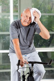 Tired senior man on home trainer Stock Photography