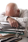 Tired senior man with papers Stock Images