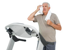 Tired senior man running on a treadmill Royalty Free Stock Photography