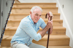 Tired senior man sitting on stairs. At home Royalty Free Stock Photo