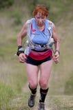Tired senior runner. PAVIE, FRANCE - MAY 22, 2011: Tired senior runner at the Trail of Pavie, on May 22, 2011, in Pavie, France stock image
