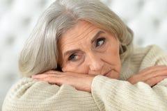 Tired senior woman Stock Photos