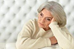 Tired senior woman Stock Photography