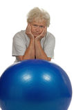 Tired senior woman with a fitball Royalty Free Stock Images
