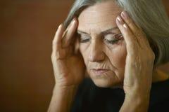 Tired senior woman Stock Image