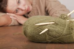 Tired after the session of learning to knit Stock Photography
