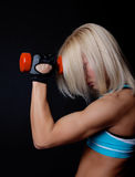 Tired sexy blonde doing exercise Royalty Free Stock Image