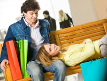 Tired shopaholics Stock Images