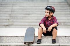Tired of skateboarding Stock Image